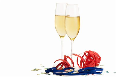 party celebration paper confetti - two champagne glasses with blow-outs and confetti on white background Stock Photo - Budget Royalty-Free & Subscription, Code: 400-04766818