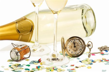 party celebration paper confetti - two glasses with champagne, old pocket watch, cork and confetti in front of a champagne bottle on white background Stock Photo - Budget Royalty-Free & Subscription, Code: 400-04766813