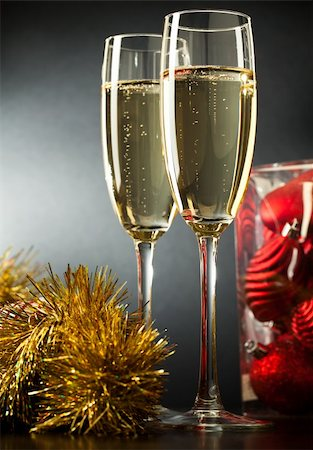 Two full glasses of champagne over gray background Stock Photo - Budget Royalty-Free & Subscription, Code: 400-04767443