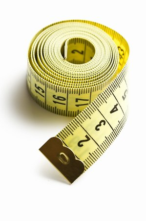 yellow measuring tape on white background Stock Photo - Budget Royalty-Free & Subscription, Code: 400-04768654