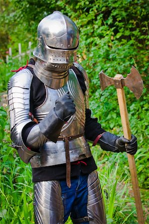 knight in shining armor on a green background Stock Photo - Budget Royalty-Free & Subscription, Code: 400-04769107