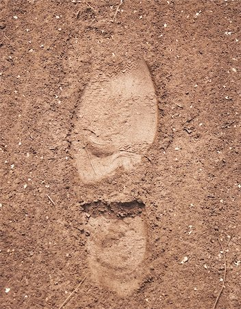 imprint of the soles on the sandy road Stock Photo - Budget Royalty-Free & Subscription, Code: 400-04778855