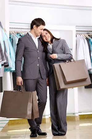 Attractive young couple with purchases in shop Stock Photo - Budget Royalty-Free & Subscription, Code: 400-04778973