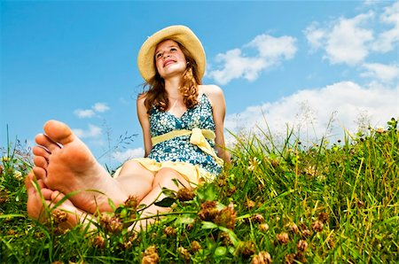 Young teenage girl sitting on summer meadow barefoot Stock Photo - Budget Royalty-Free & Subscription, Code: 400-04771100