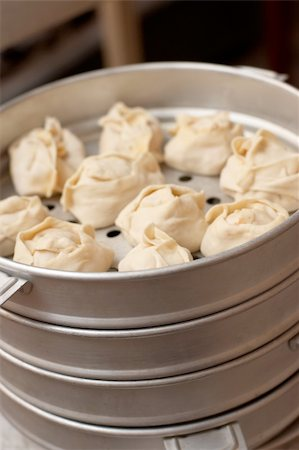 dumplings steamer - Oriental metall steam cooker with dumplings (manty) Stock Photo - Budget Royalty-Free & Subscription, Code: 400-04785115