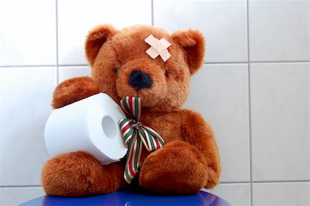 toy teddy bear with paper in the bathroom on toilet Stock Photo - Budget Royalty-Free & Subscription, Code: 400-04796222