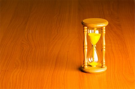 sand clock - Time concept with hourglass against background Stock Photo - Budget Royalty-Free & Subscription, Code: 400-04791591