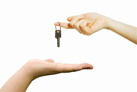 simsearch:400-05936191,k - hand holds a key isolated on white Stock Photo - Budget Royalty-Free & Subscription, Code: 400-04805219