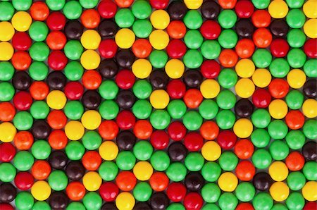 Background of colorful candies coated chocolate sweets Stock Photo - Budget Royalty-Free & Subscription, Code: 400-04809518