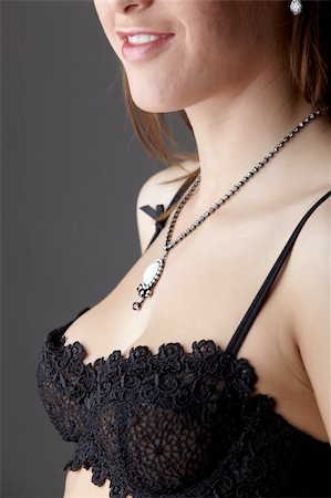 small breasts woman nude - Young adult caucasian woman wearing black lace lingerie on a neutral grey background. Stock Photo - Budget Royalty-Free & Subscription, Code: 400-04802264