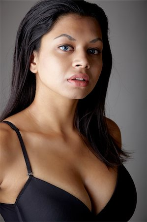 female naked large breasts or boobs - Young voluptuous Indian adult woman with long black hair wearing black lingerie and blue coloured contact lenses on a neutral grey background. Mixed ethnicity Stock Photo - Budget Royalty-Free & Subscription, Code: 400-04802286