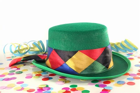 party celebration paper confetti - Carnival hat with colorful confetti and streamers on white background Stock Photo - Budget Royalty-Free & Subscription, Code: 400-04802434