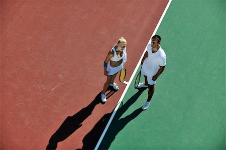 happy young couple play tennis game outdoor man and woman Stock Photo - Budget Royalty-Free & Subscription, Code: 400-04814510