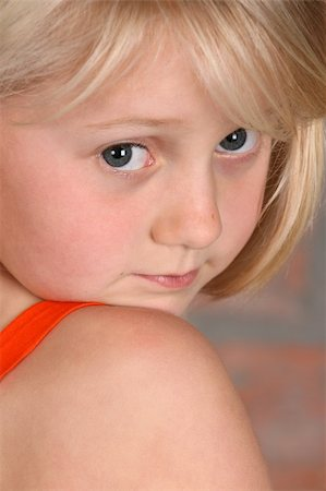 Beautiful little blond girl wearing casual clothes Stock Photo - Budget Royalty-Free & Subscription, Code: 400-04815912