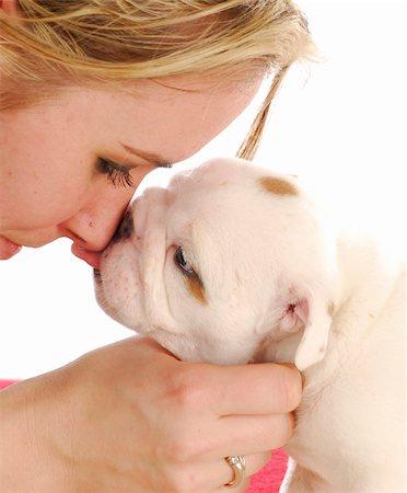 dog kissing girl - english bulldog puppy kissing woman on the nose Stock Photo - Budget Royalty-Free & Subscription, Code: 400-04817765