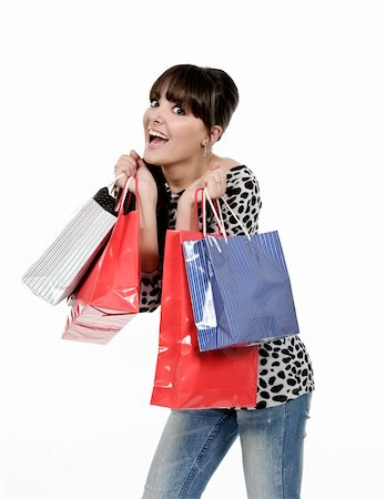 young woman shopping with gift bags in hand Stock Photo - Budget Royalty-Free & Subscription, Code: 400-04818514