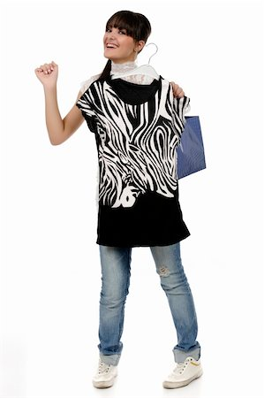 young woman shopping. has a hanger in his hand and a shirt and a bag Stock Photo - Budget Royalty-Free & Subscription, Code: 400-04818518