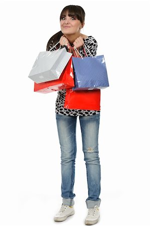 young woman shopping with gift bags in hand Stock Photo - Budget Royalty-Free & Subscription, Code: 400-04818513