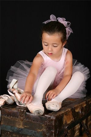 Cute little ballet girl trying on pointe shoes Stock Photo - Budget Royalty-Free & Subscription, Code: 400-04819710