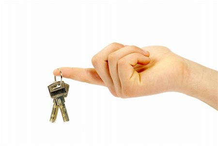 simsearch:400-05936191,k - hand holds a key isolated on white Stock Photo - Budget Royalty-Free & Subscription, Code: 400-04813211