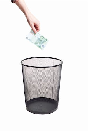 hand gold euro to trash can isolated Stock Photo - Budget Royalty-Free & Subscription, Code: 400-04825362