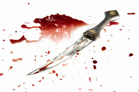 A knife is covered with a fresh blood. Isolated on white Stock Photo - Budget Royalty-Free & Subscription, Code: 400-04829630