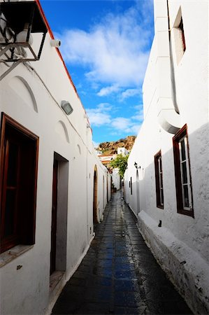 Narrow Alley With Old Buildings In Typical Greek City Stock Photo - Budget Royalty-Free & Subscription, Code: 400-04822326