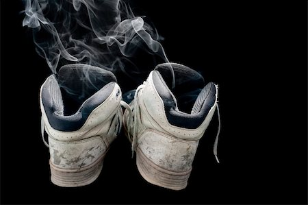 dirty old pair of sneakers on a black background Stock Photo - Budget Royalty-Free & Subscription, Code: 400-04836542