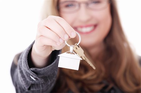 finger holding a key - Young businesswoman (real estate agent) with house keys in hand Stock Photo - Budget Royalty-Free & Subscription, Code: 400-04836628