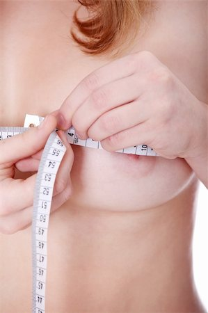 Beautiful, young woman measuring her breast Stock Photo - Budget Royalty-Free & Subscription, Code: 400-04836621