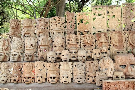 Mayan wood mask rows Mexico handcraft faces indian culture Stock Photo - Budget Royalty-Free & Subscription, Code: 400-04837561