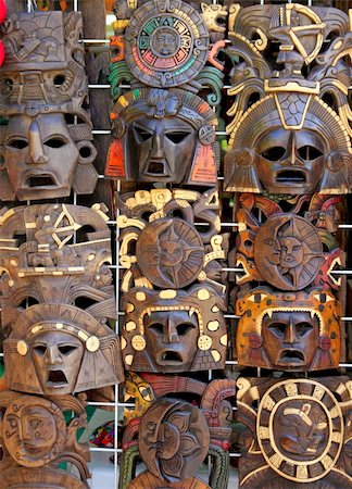 aztec mayan wooden Mexican indian mask handcrafts in rows Stock Photo - Budget Royalty-Free & Subscription, Code: 400-04833070