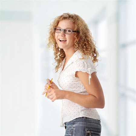 Beautiful corpulent caucasian student girl isolated on white background Stock Photo - Budget Royalty-Free & Subscription, Code: 400-04844961