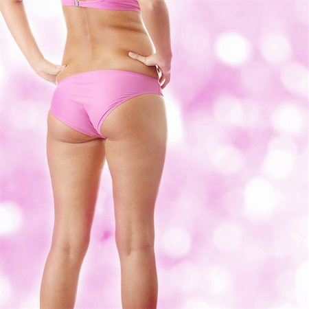 Beautiful model back in pink bikini Stock Photo - Budget Royalty-Free & Subscription, Code: 400-04844995