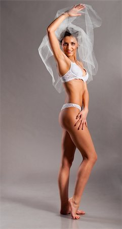 beautiful bride is standing in lingerie and wedding veil and looking at camera Stock Photo - Budget Royalty-Free & Subscription, Code: 400-04846795