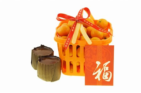 Gift basket of mandarin oranges and Chinese new year rice cakes  on white background Stock Photo - Budget Royalty-Free & Subscription, Code: 400-04855672