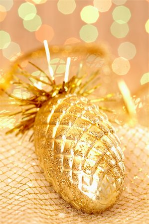 simsearch:400-05749231,k - Golden Christmas pinecone against glaring background Stock Photo - Budget Royalty-Free & Subscription, Code: 400-04856568