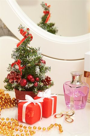 simsearch:400-05749231,k - Christmas composition on lady toiletries table Stock Photo - Budget Royalty-Free & Subscription, Code: 400-04856591
