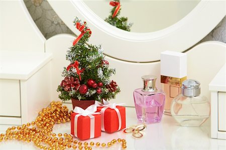 simsearch:400-05749231,k - Christmas composition on lady toiletries table Stock Photo - Budget Royalty-Free & Subscription, Code: 400-04856592