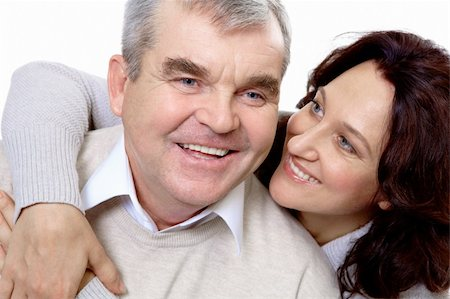 Portrait of attractive middle aged woman embracing her happy husband Stock Photo - Budget Royalty-Free & Subscription, Code: 400-04856610