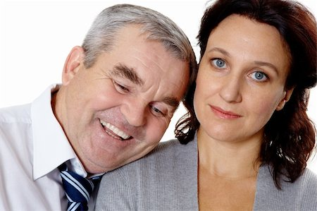 Portrait of middle aged woman looking at camera with happy man laughing near by Stock Photo - Budget Royalty-Free & Subscription, Code: 400-04856612