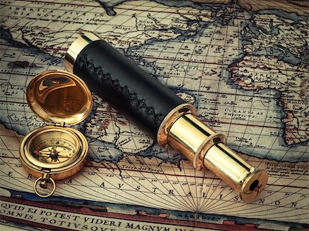scope - traveling theme: vintage telescope and compass at antique (17 century) map Stock Photo - Budget Royalty-Free & Subscription, Code: 400-04858894