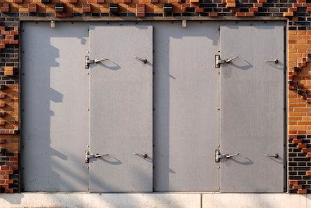 flooded homes - Iron shutter in Hamburg protecting house against flood disaster and high tide. Stock Photo - Budget Royalty-Free & Subscription, Code: 400-04859016