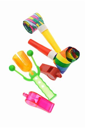 paper blower - Colorful party horn, blowers, whistles and click clack on white Stock Photo - Budget Royalty-Free & Subscription, Code: 400-04866130
