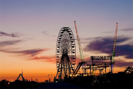 Silhouette of amusement park in the evening light of sunset in Cyprus Stock Photo - Budget Royalty-Free & Subscription, Code: 400-04868731