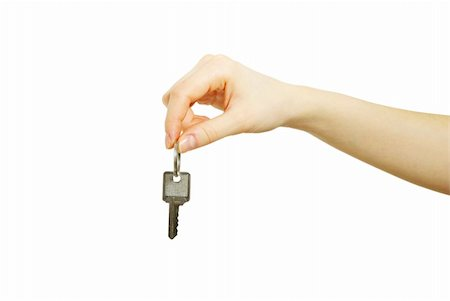 simsearch:400-05936191,k - hand holds a key isolated on white Stock Photo - Budget Royalty-Free & Subscription, Code: 400-04869201