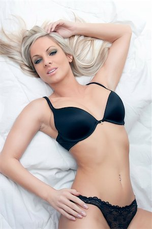beautiful sexy blond girl in black lingerie lying Stock Photo - Budget Royalty-Free & Subscription, Code: 400-04860972