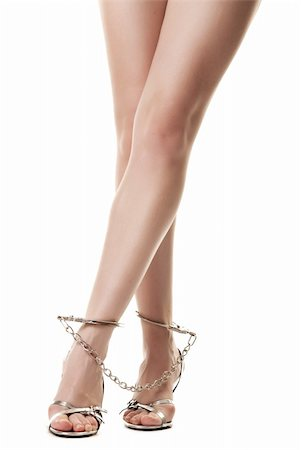A pair of long handcuffed female legs isolated on white background Stock Photo - Budget Royalty-Free & Subscription, Code: 400-04863139