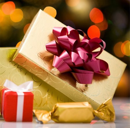 simsearch:400-05749231,k - Close-up of gift boxes and sweets on holiday background Stock Photo - Budget Royalty-Free & Subscription, Code: 400-04876358
