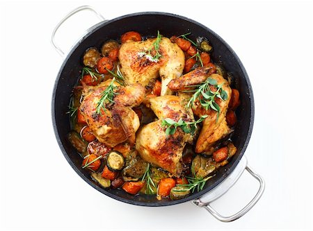Tasty roasted chicken with vegetable and herbs Stock Photo - Budget Royalty-Free & Subscription, Code: 400-04876558